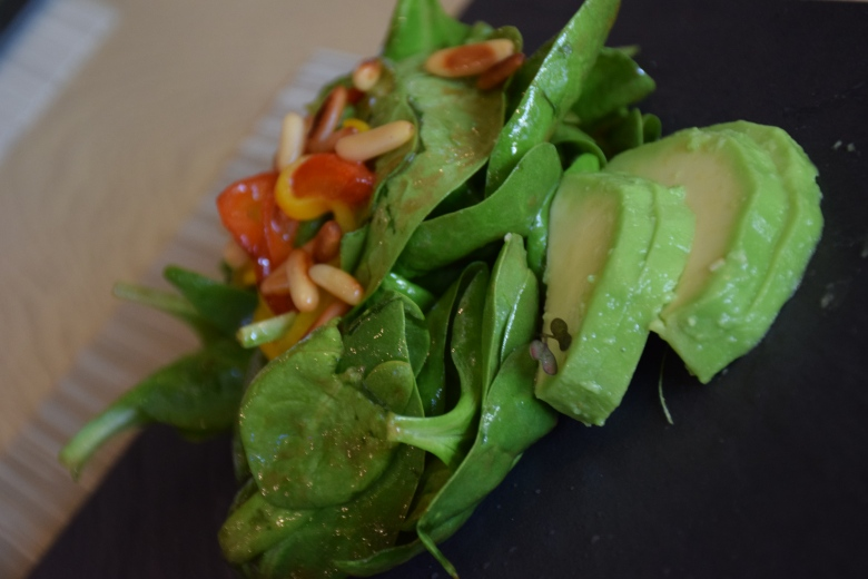 Baby spinach, avocado and roast peper salad with pine nuts and balsamic dressing