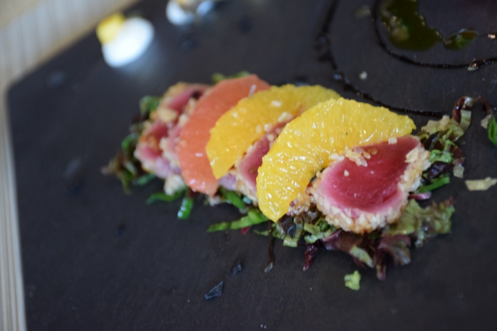 Sesame and honey coated tuna loin accompanied by sicilian orange salad drizzled with organic pink grapefruit